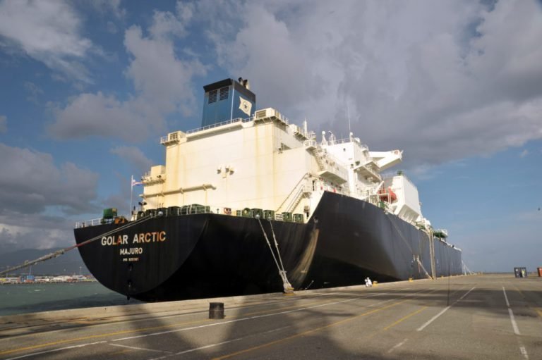 Large carrier ship docked at a port in Jamaica carrying first shipment of natural gas of LNG Plant