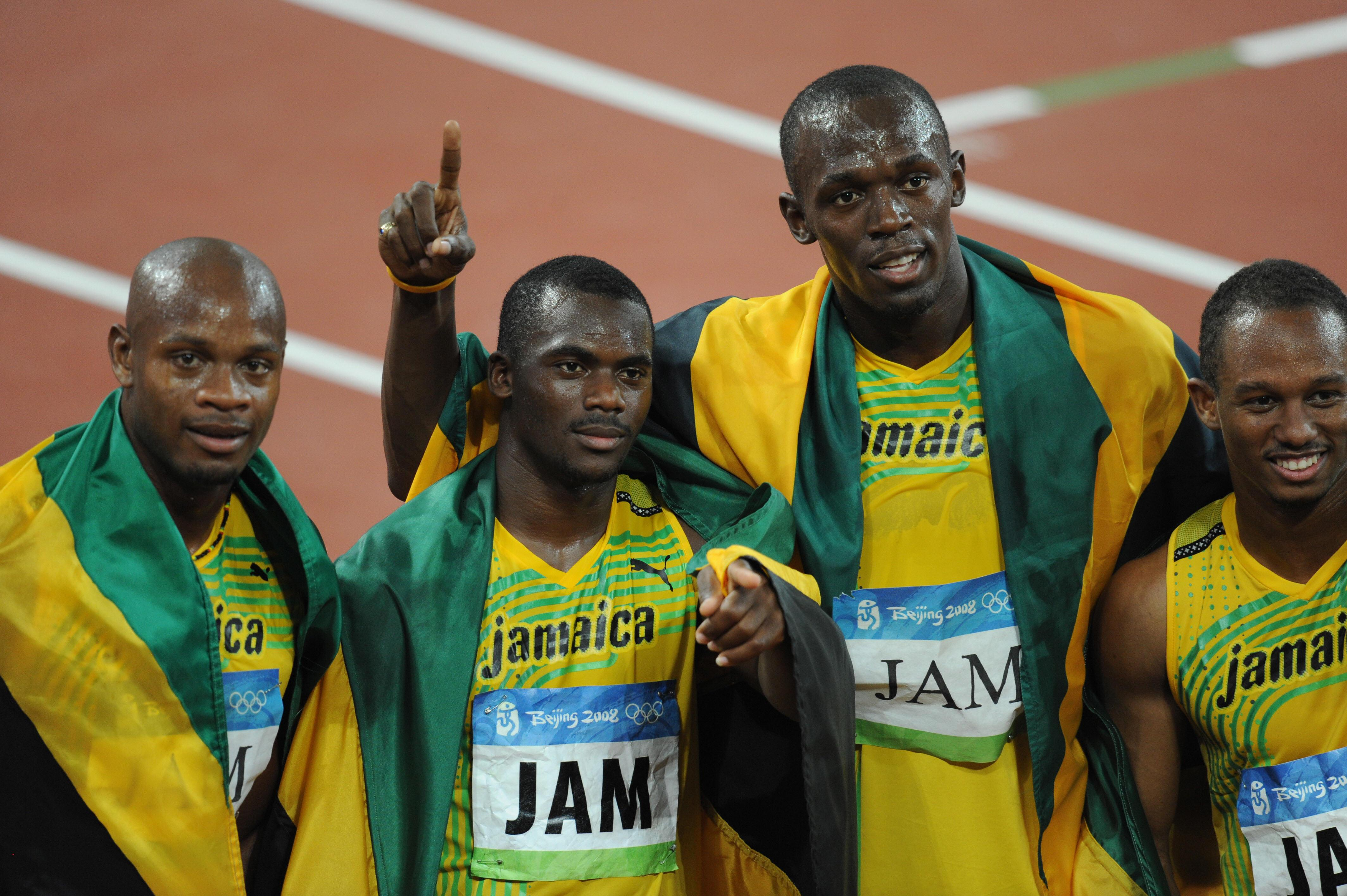 Four Jamaican athletes celebrate after winning the Gold medal in Beijing