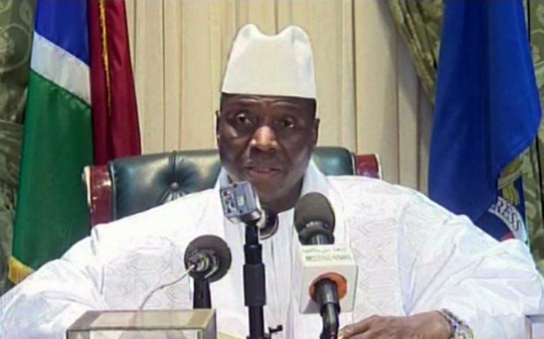 Gambian President Yahya Jammeh speaking into microphones on state television