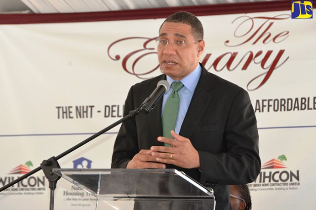 Prime Minister Andrew Holness in front of podium discusing culture of disorder
