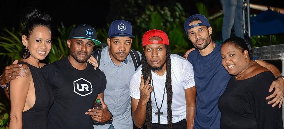 Four men posing side by side