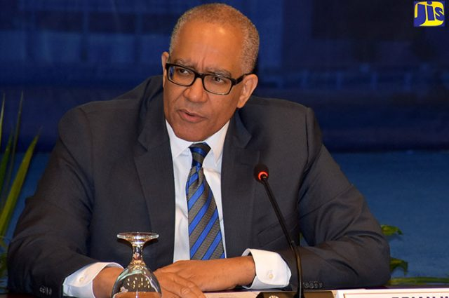 Bank of Jamaica (BOJ) Governor, Brian Wynter, talking into microphone