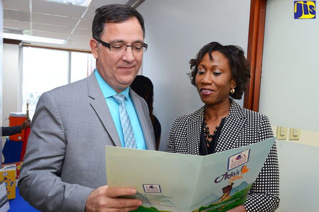 Children's Advocate, Diahann Gordon Harrison (right), shares details of 'Aria's Story' with High Commissioner of Canada to Jamaica, His Excellency Sylvan Fabi, prior to the recent launch at the Office of the Children's Advocate (OCA) in downtown Kingston. The public-education campaign, which is an initiative of the OCA, is an online animated miniseries being rolled out across various social media platforms.