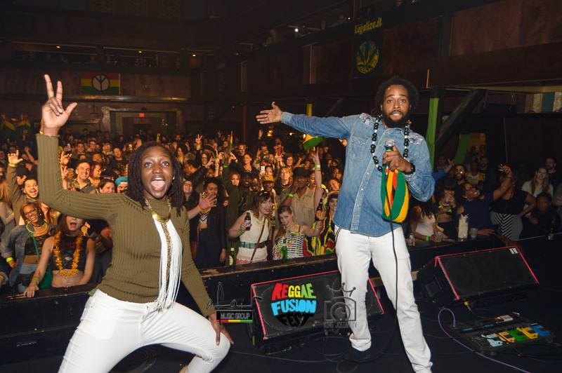 Clara and Jah Ques performing on stage