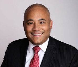 Headshot of Michael Coteau wearing a suit