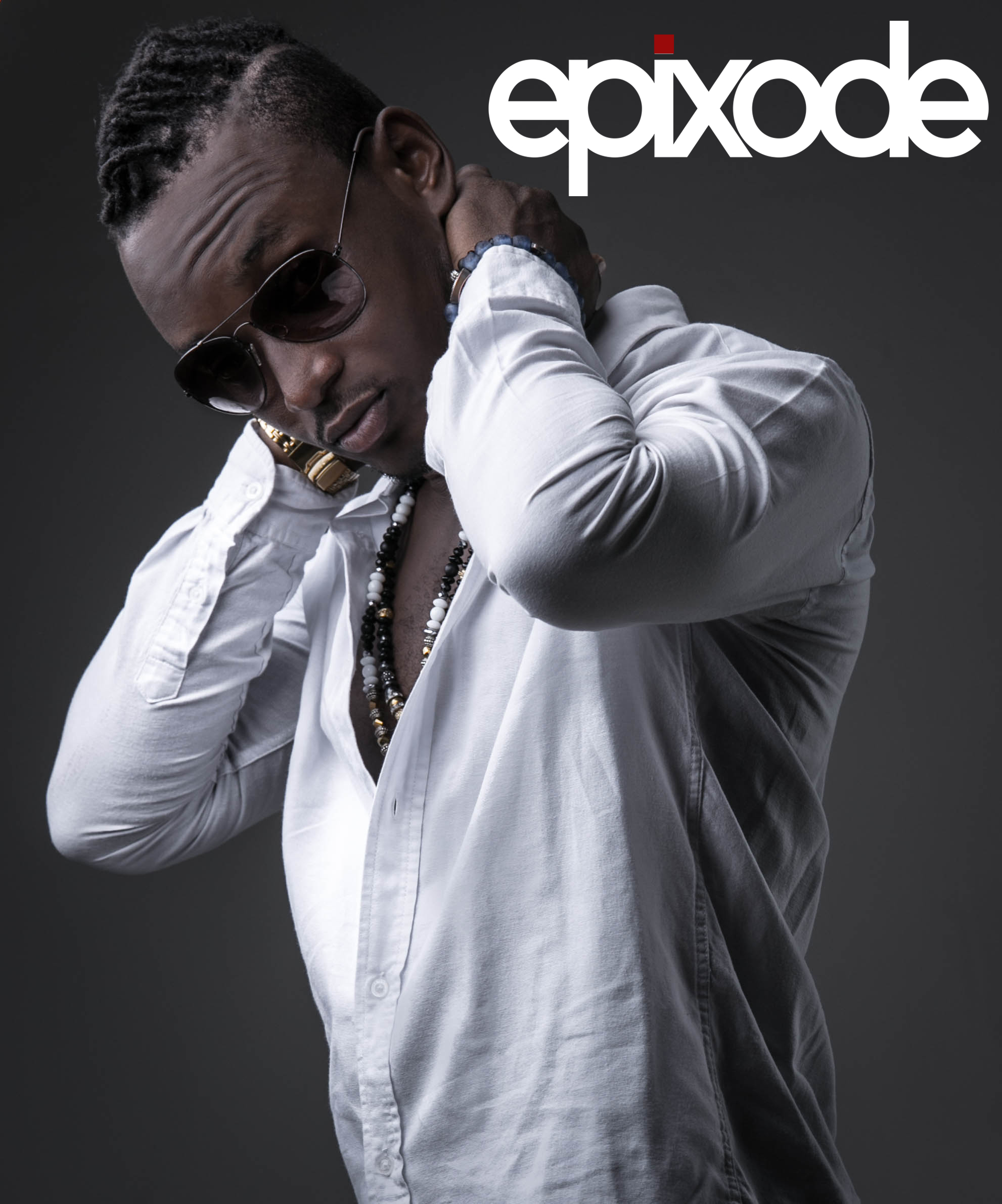Music artist Epixode posing with his hands behind his head