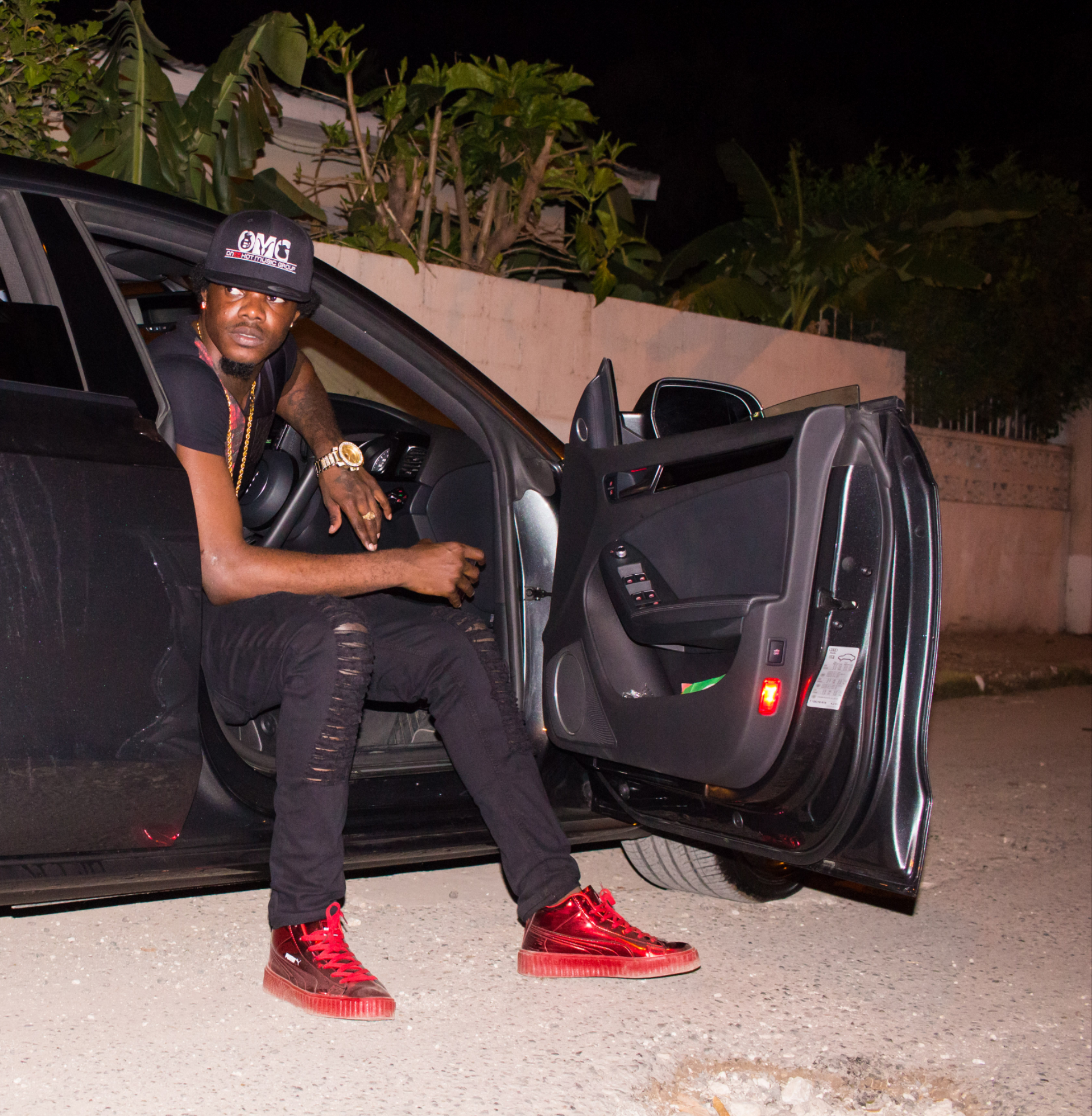 Dancehall artist Giannii sitting in the passenger side of a car