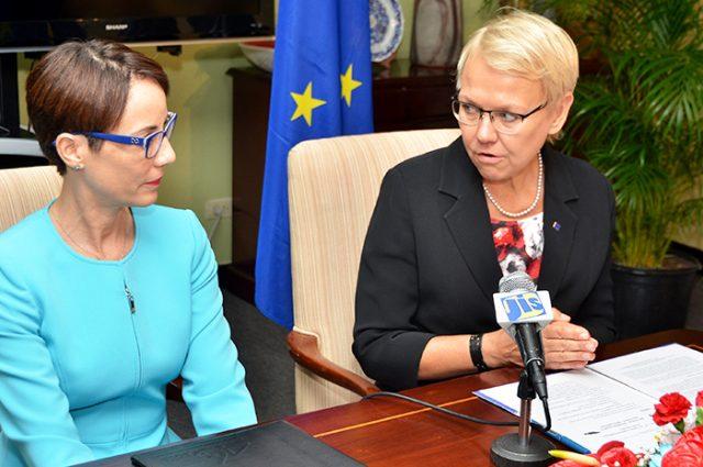 Senator Kamina Johnson Smith and Ambassador Malgorzata Wasilewska sitting at a table with a microphone discussing trade relations