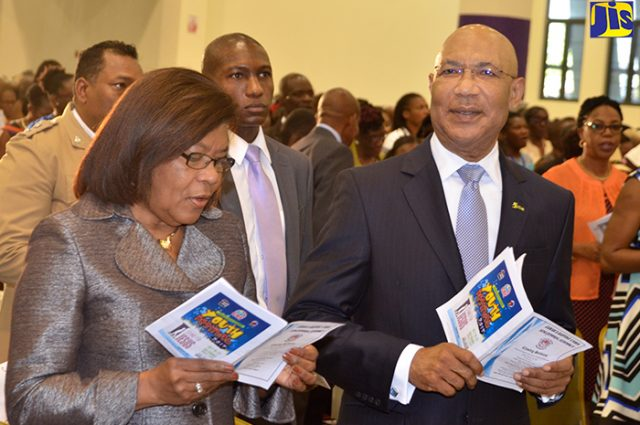 Governor General Sir Patrick Allen and Chief Justice Zaila McCalla, sing a hymn at the Jamaica Baptist Union