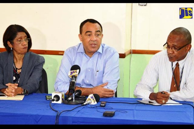 Minister of Health, Dr. the Hon. Christopher Tufton talking in a microphone addressing Action to Address Problem at Cornwall Regional Hospital