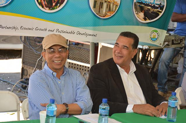 Hon. Dr. Horace Chang (left), shares a joke with Montego Bay Mayor, Councillor Homer Davis