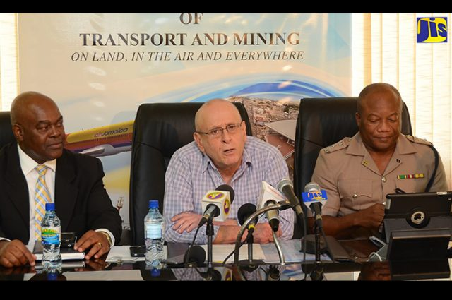 Chairman of the Transport Authority sitting in front of a microphone addressing vehicle Removal of Tints