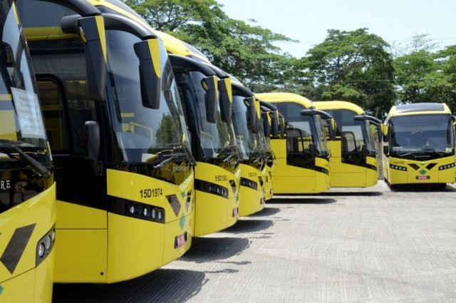 Five yellow buses for the Jamaica Urban Transit Company lined up