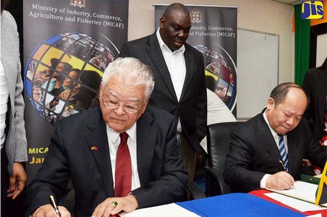 Government Men signing framework agreement