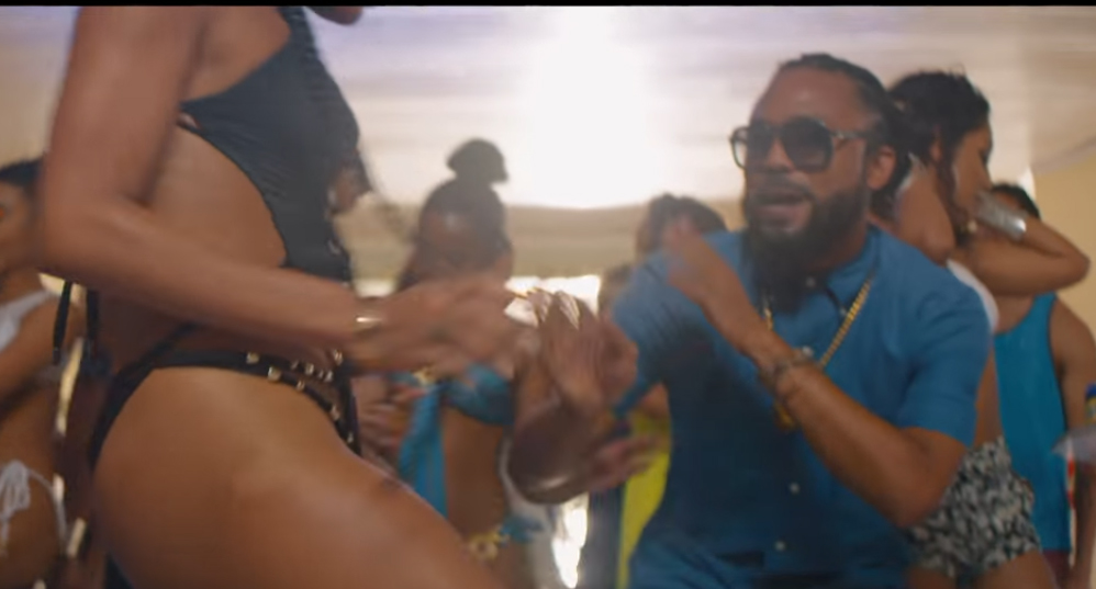 Machel Montano dancing with a lady for his music video Fast Wine