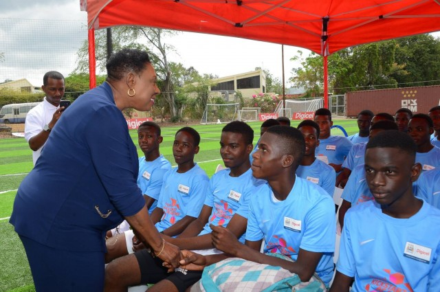 Minister of Culture, Gender, Entertainment and Sport, Olivia Grange speaks to young footballers at the launch of the Digicel Kickstart Clinic