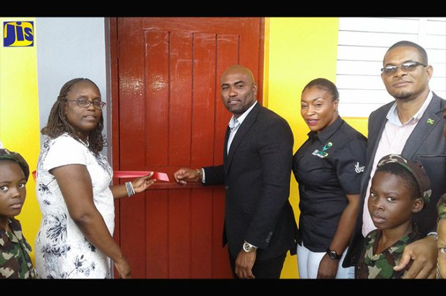 Minister of Science, Energy and Technology, Dr. the Hon. Andrew Wheatley (third left), opens the Mount Peto Primary School Computer Laboratory, at the Mount Peto Baptist Church in Hanover on February 17. Sharing the occasion (from second left) are Principal of the Mount Peto Primary School, Nadienne Crossman; Chief Executive Officer of the Universal Service Fund, Suzette Buchanan; Member of Parliament for Eastern Hanover, Dave Brown and students of the school.