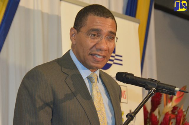 Prime Minister, the Most Hon. Andrew Holness talking in a microphone about pension fund