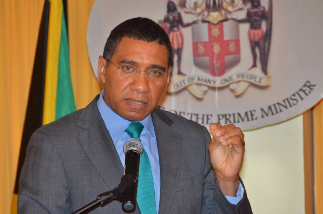 Prime Minister Andrew Holness speaking into a microphone about budget