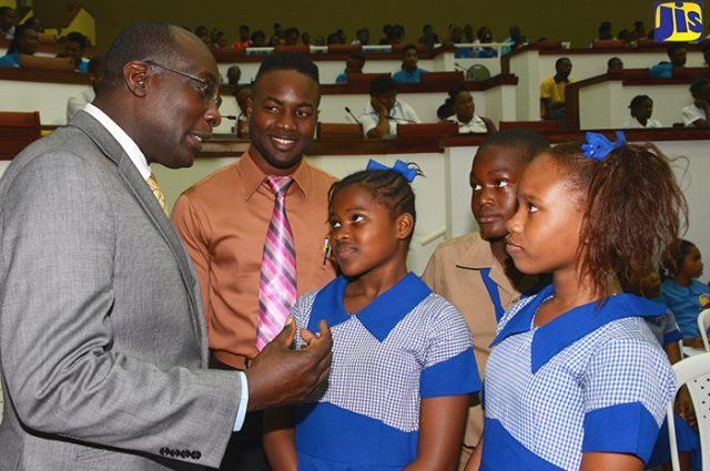 Senator the Hon. Ruel Reid speaking to children urging them to become developers of goods and services