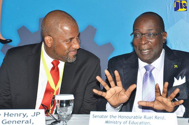 Senator the Hon. Ruel Reid talking to Director General Wayne Henry about apprenticeship system for Jamaica