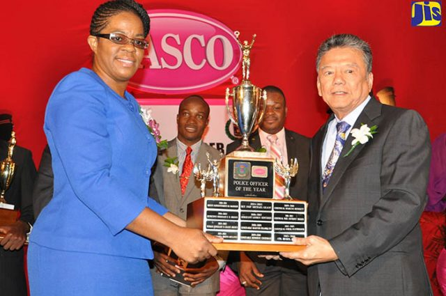 Detective Sergeant, Ava Lindo, receives the LASCO Police Officer of the Year trophy