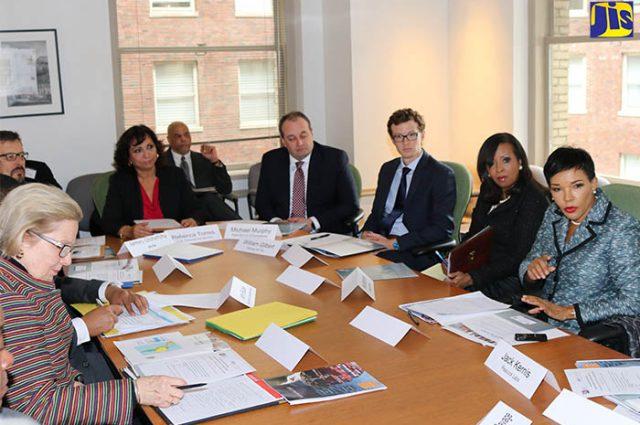 Executives discussing Jamaica's Business