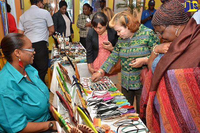 Local entrepreneur and artist display locally made craft items