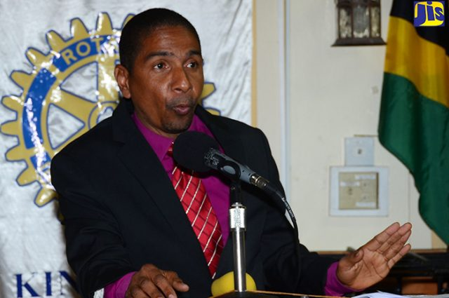 Mayor Williams speaking in microphone discussing plans for downton kingston
