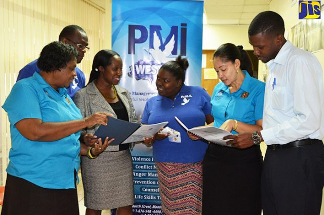 Members of Staff of the Peace Management Initiative (PMI) Western