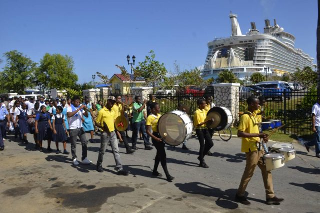 Members of the Spot Valley High School Marching Band from St. James from Falmouth marching down the road