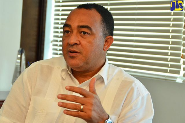 Minister of Health, Dr. the Hon Christopher Tufton discussing outpatient services