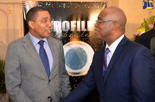 Ian Boyne takes picture with Prime minister Andrew Holness