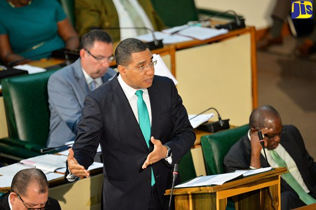 Prime Minister the Most. Hon. Andrew Holness (2nd right), emphasises a point about sweetened drinks