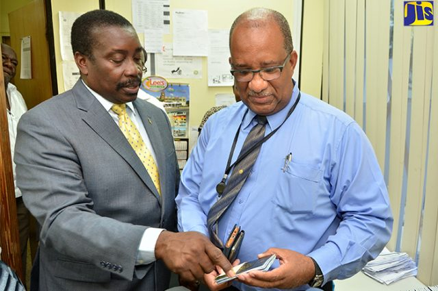 Robert Montague and Andrew Wynter going over new passports at PICA