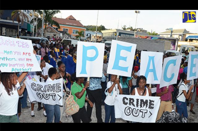 large crowd which taking part in a Peace March for campaign against violence