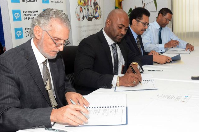 the signing of a partnership agreement to establish the PCJ Renewable Energy Scholarship