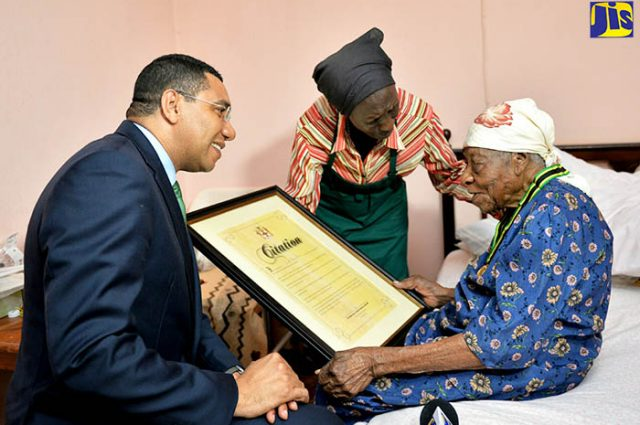 Andrew Holness gives award to Violet Mosse-Brown for world's oldest living person