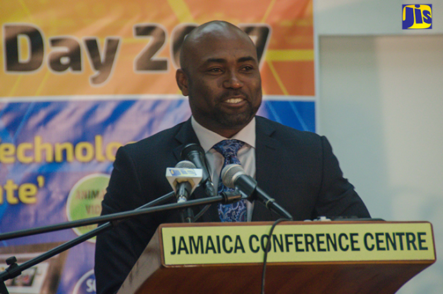 Andrew Wheatley, delivers greetings at the e-Learning Jamaica Technology Day on tablets