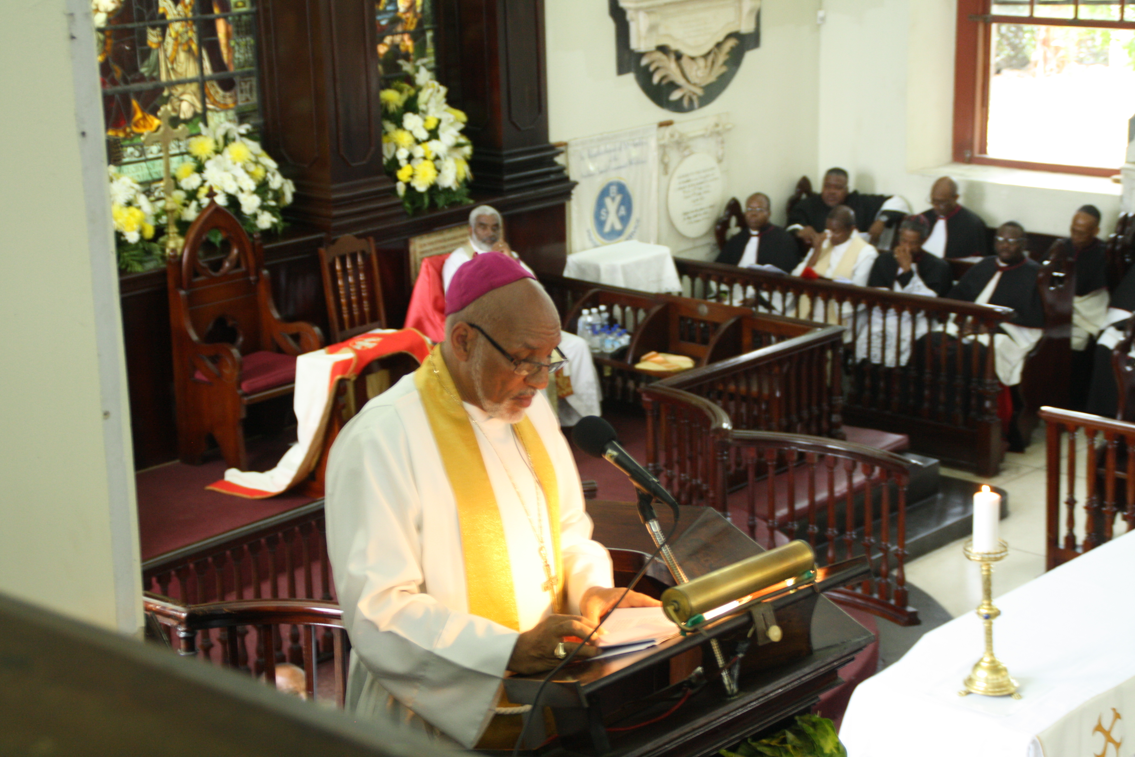 Bishop Gregory delivers Chard in front of a podium at 147th Synod
