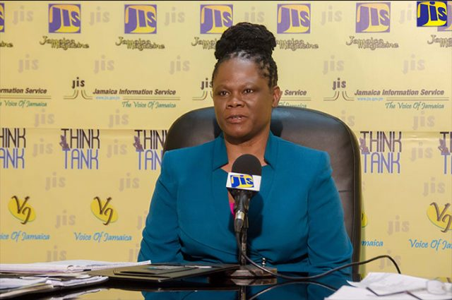 Lady in front of a microphone announcing the CCCJ conference