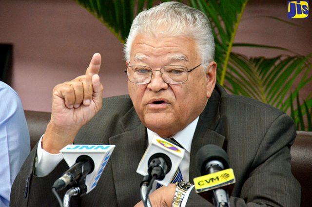 Minister Samuda speaking in microphones