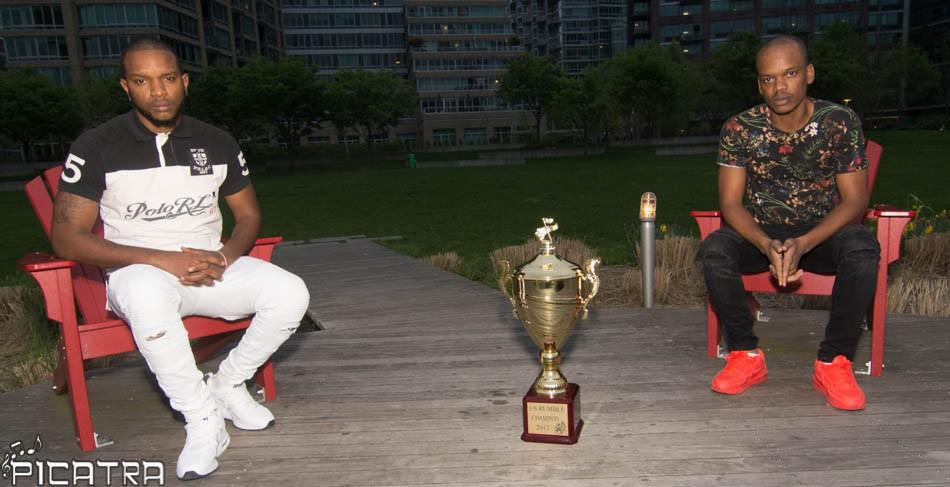 Platinum Kids sitting beside a trophy