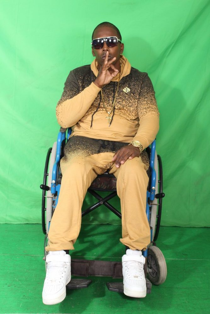 Artist Real V.I sitting in a wheelchair