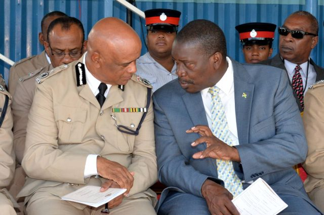 Robert Montague highlights a point to Commissioner of Police