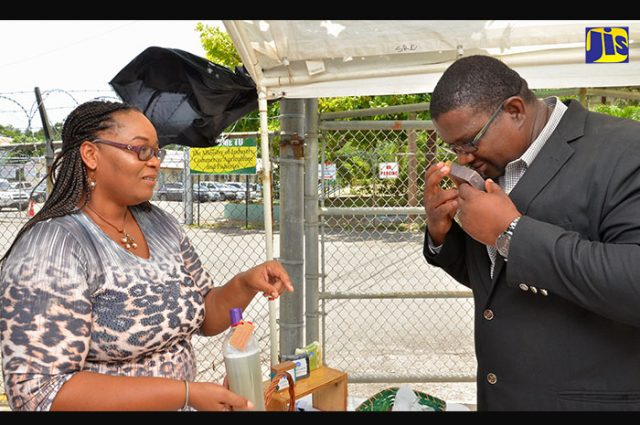 People smelling local Jamaican body care products