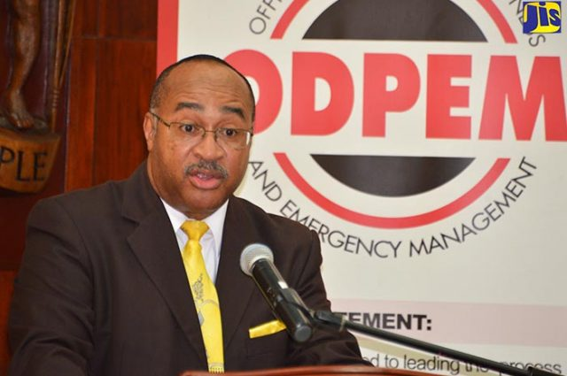 ODPEM director talking in a microphone about being disaster ready to Vision Newspaper Caribbean News