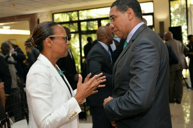Prime minister holness taking with IBD manager about e-Governance captured by Vision newspaper Caribbean news