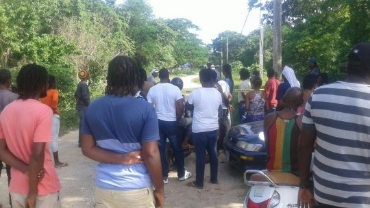 Crowd gathered where missing women's body found in a shallow grave shown to Vision Newspaper Caribbean News