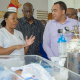 Ministry and nurse discussing contruction of housing for health care workers